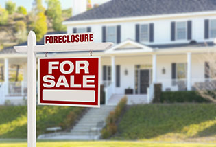 foreclosure sign in front of the house